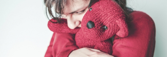 girl hugging a bear